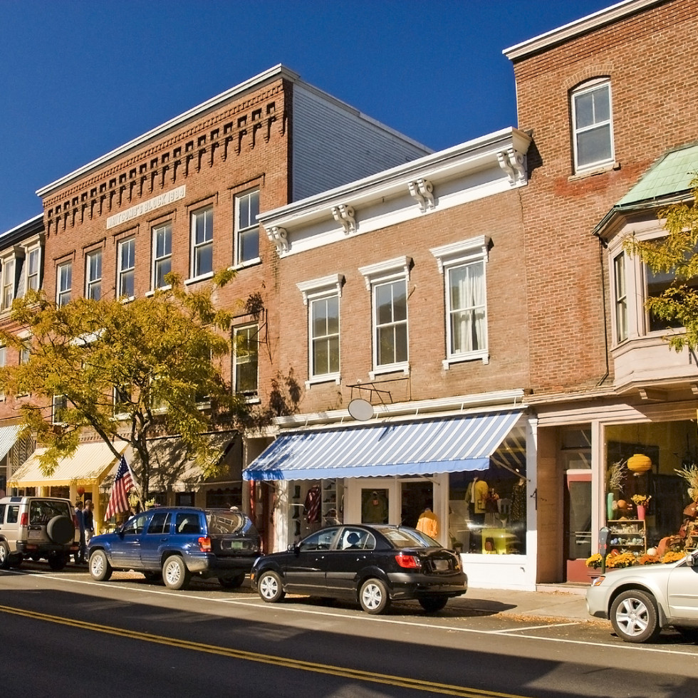 Typical New England or Midwest downtown main street. This street scene could be any small town U.S.A. Old brick buildings turned into small businesses shops and cafe's. ** Note: Slight graininess, best at smaller sizes