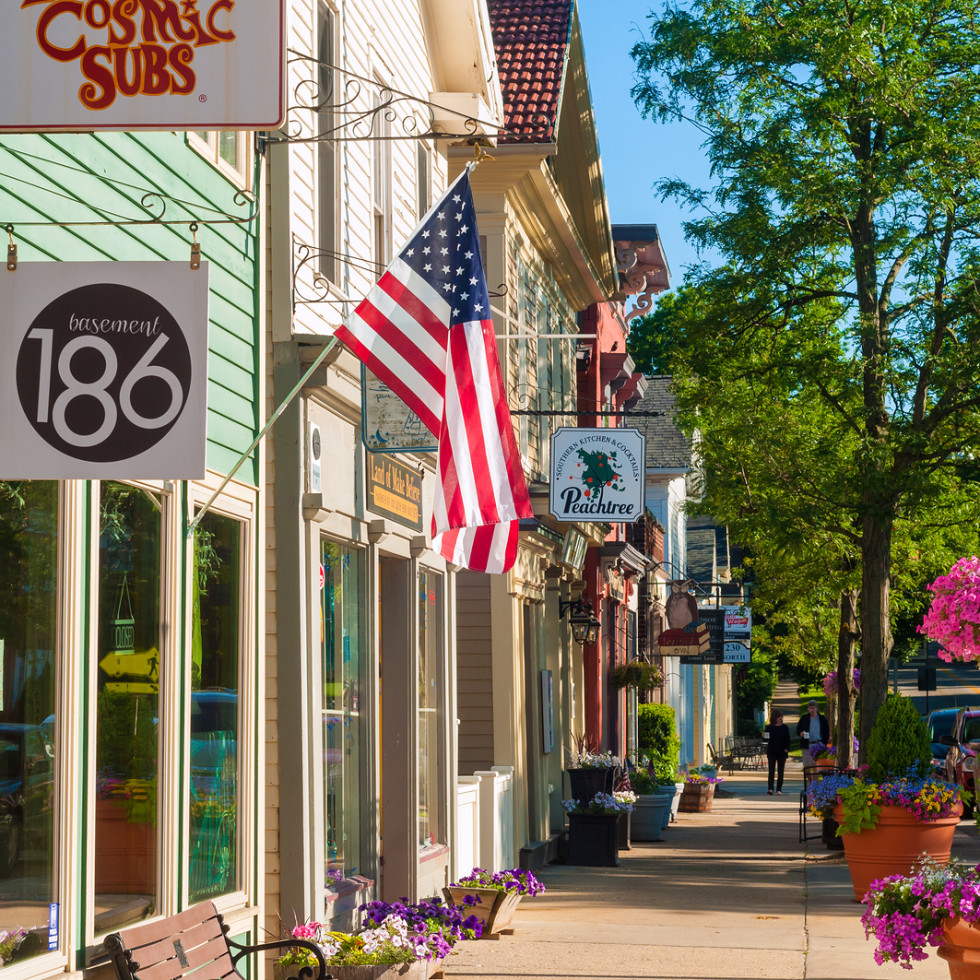 HUDSON OH - JUNE 14 2014: Quaint shops and businesses give Hudson's Main Street a charming and inviting appearance that attracts visitors from all over Northeast Ohio.